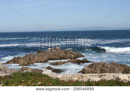 This Is An Image Of Rocks, Waives And Plant Life Taken Along The Shoreline Of Pacific Grove, Califor