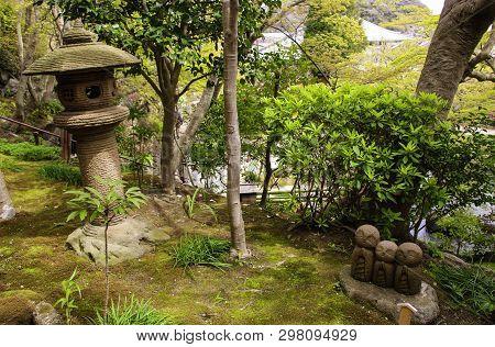 Kamakura, Japan - April 05, 2019: Stone Statue Of Three Smiling Jizo (nagomi Jizo), Hasedera Temple,