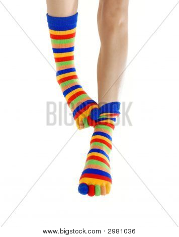 Thin legs in colored socks scratching each other poster