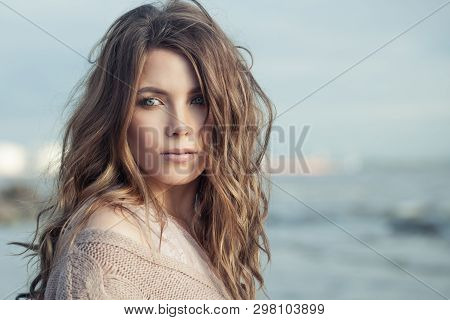 Outdoors Portrait Of Cute Woman. Beautiful Model Girl With Brown Curly Hair And Natural Makeup