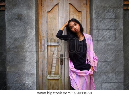 Asian Woman Infront Of Door
