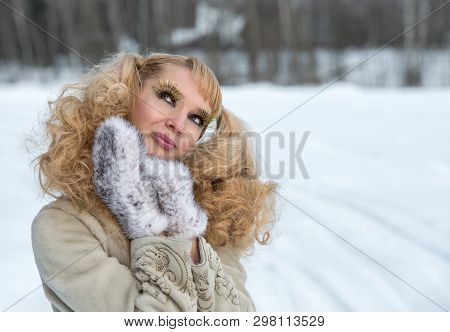 Giddy Young Woman With Exaggerated Cilia In A Winter Field