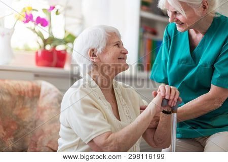Senior woman with her female caregiver