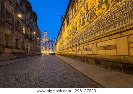 Dresden, Germany - April 19, 2019: Furstenzug giant mural decorates mosaic on the wall of Augustus Street in Dresden, Germany