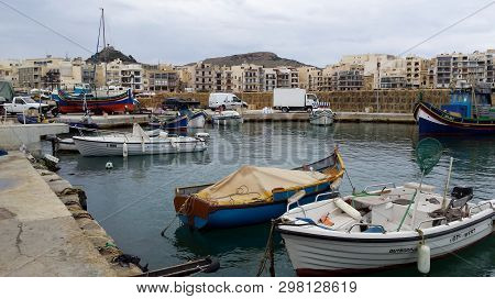 Marsalforn, Gozo, Malta.- Circa April 2019 - Fishing Boats Await Their Owners At The Seaside Town Of