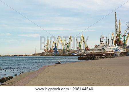 Feodosia, Crimea, Russia - March 08, 2019: Cargo Seaport In The Resort Town Of Feodosia In Crimea. O