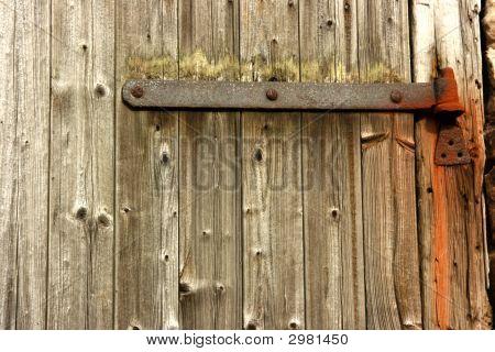 Plain Wooden Door With Rusty Steel Hinge