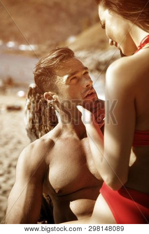 Young beautiful couple on a tropical beach