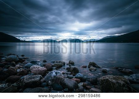Mystic Landscape Lake Scenery In Scotland: Cloudy Sky, Sunbeams And Mountain Range In Loch Linnhe