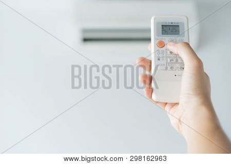 Woman Hand Using Remote Control Open Air Conditioning 25 Degrees. Open Air 25 Degrees, Is Temperatur
