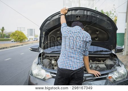Mechanic Wearing Gloves Open Car Hood Checking Car Engine Oil On The Road After Car Breakdown Proble