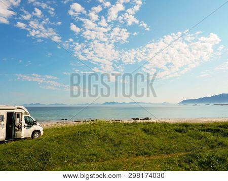 Camper Van Motor Home On Sea Coast Gimsoysand Beach In Summer. Camping On Ocean Shore. Lofoten Archi