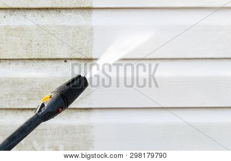 Cleaning Service Washing Building Facade With Pressure Water. Cleaning Dirty Wall With High Pressure