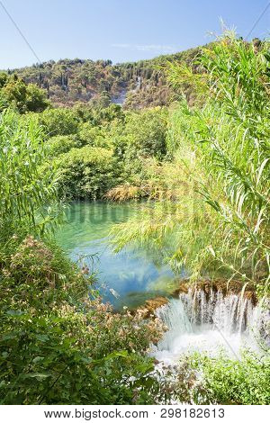 Krka, Sibenik, Croatia, Europe - Water Reed At A Small Downfall Within Krka National Park