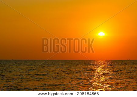 Bright Sunset With Large Yellow Sun Above The Sea Surface. Last Colors The Day. Summer Vacation And