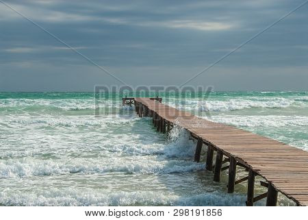 A Jetty In A Bay On The Beach Of Mallorca