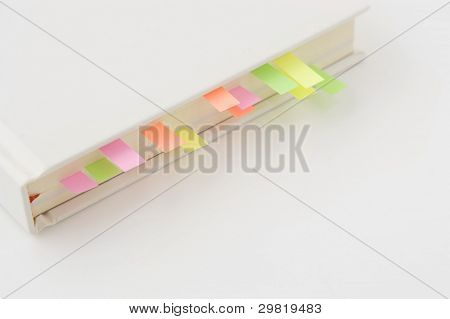 Books with bookmarks on white background.