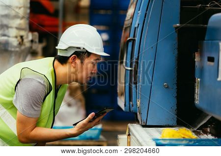 Young Asian Male Heavy Industrial Worker In Workwear Uniform Monitoring And Quality Control Use A Ta