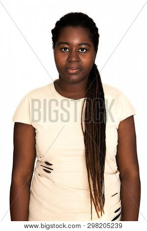 Serious black woman portrait. African woman is posing on white background.