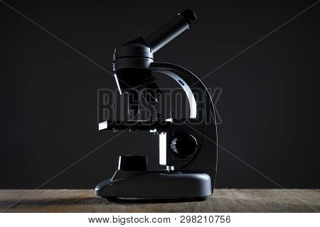Close Up Of A Microscope In A Dark Room