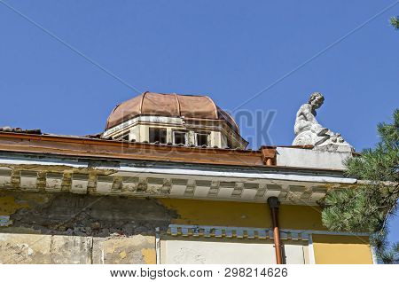 Klisura Monastery, Bulgaria - July 21, 2018: Part of the old Architectural Ensemble Banite with a fragment of the New Mineral Bath, Sun Garden, Varshets spa town, Montana Province, Bulgaria, Europe. Visit in place. poster