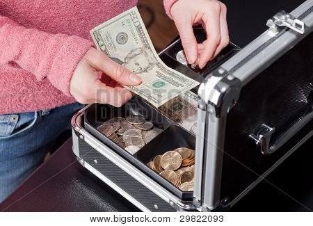 Woman Making Change From A Cash Box