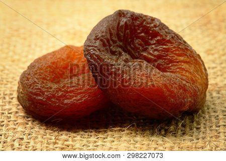 Two Sundried Apricots On Sackcloth (studio Shoot Image)