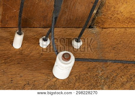 Old Outdated Electrical Wiring In The Ceiling Of An Old House.
