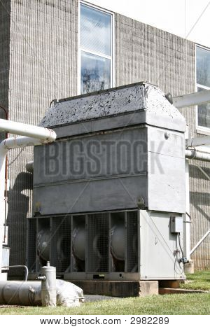 Large exterior structure of industrial exhaust and pipes. poster