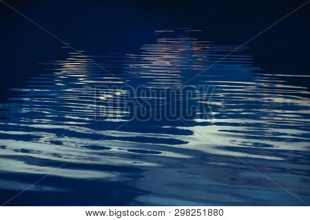 Amazing Textured Background Of Calm Dark Blue Clean Water Surface. Dawn Reflected In Mountain Lake C