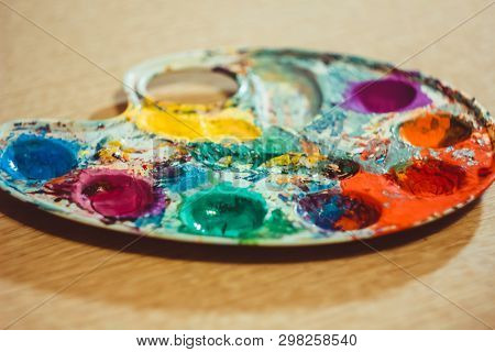 The Palette Water Paints On The Table,many Color In The Palette Water Paints
