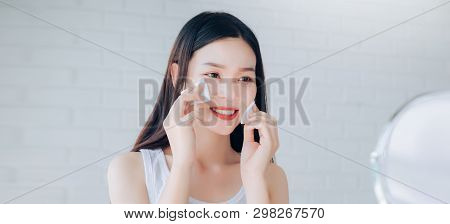 Young Beauty Asian Woman Cleaning Face With Cotton Clear Face Skincare,makeup Mirror And Smile Morni