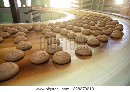 Automatic Bakery Production Line With Sweet Cookies On Conveyor Belt Equipment Machinery In Confecti