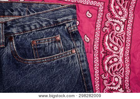 Classic Jeans With Five Pockets Close-up. Paisley Patterned Bandana, Classic Red And White Neckerchi