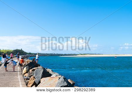 People Enjoying The Sunny Weather In The Small Fishing Village Of Crowdy Head, Famous For The Breakw