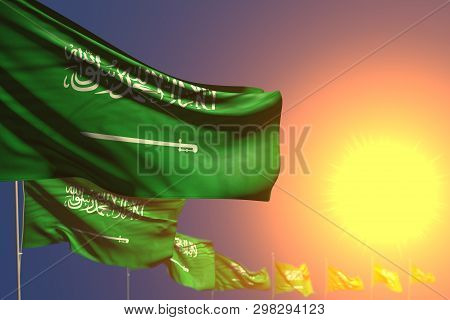 Nice Many Saudi Arabia Flags On Sunset Placed Diagonal With Bokeh And Place For Text - Any Feast Fla