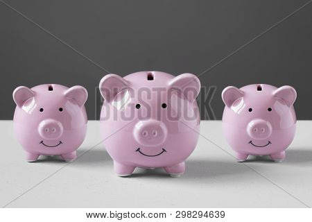 Coin Bank Or Piggybank Or Money Box Family - Finance And Savings Concept With Copy Space