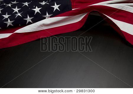US Flag on dark wooden surface