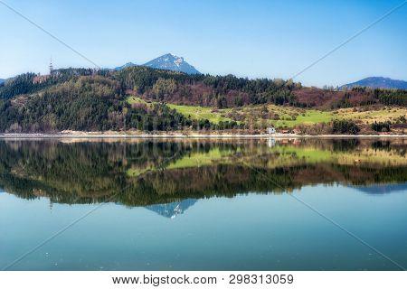 Crystal Reflection Of Hill Choč In Water Resevoir Liptovska Mara, Slovakia