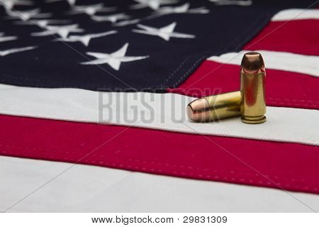 US Flag and two bullets