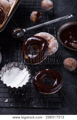 Stack Of Glazed Doughnuts On A Plate. A Close Up Of A Plate Of Fresh Glazed Doughnuts In A Studio Se