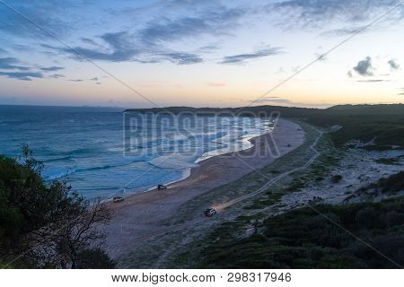 Offroad Cars On The Beach. View From The Lighthouse At Sugarloaf Point Seal Rocks, Myall Lakes Natio