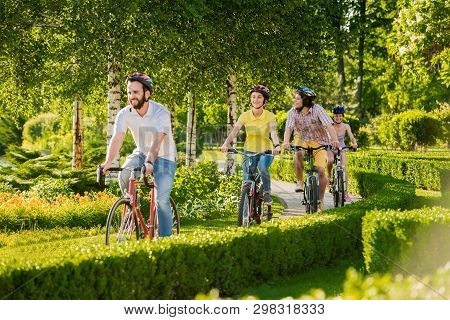 Young Happy Bikers Cycling Outdoors. Group Of Cheerful Friends Cycling During Sunny Day. Perfect Day