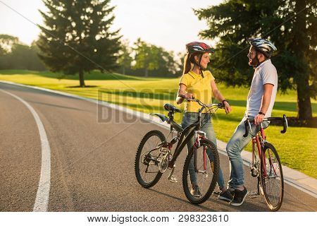 Loving Couple With Bikes On The Road. Beautiful Students In Love On Romantic Date. Couple In Love. C