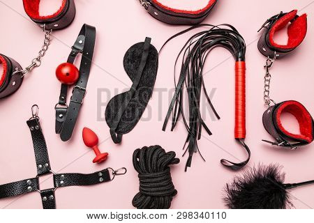 Set Of Erotic Toys For Bdsm. The Game Of Sexual Slavery With A Whip, Gag And Leather Blindfold. Inti