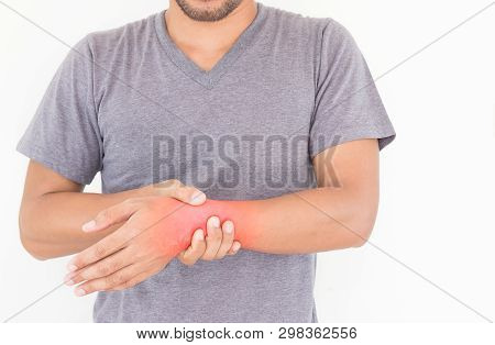 Young Man Suffering From Wrist Pain On White Background, Health Concept.