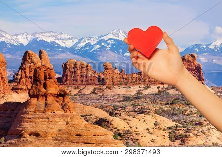 Hand Hold Red Heart Over Mt Waas And Arches Park