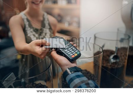 Hand Of Customer Paying With Contactless Credit Card With Nfc Technology. Waiter With A Credit Card