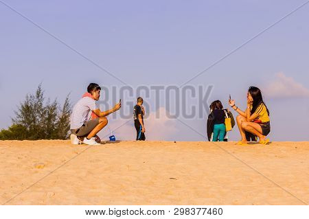 Phuket, Thailand - April 14, 2019: A Couple Of Tourists Were Taking A Picture Of Each Other While Wa