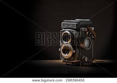 A Seagull 4 Tlr Twin Lens Reflex Camera With Brown Strap On A Table With A Black Background, Notting